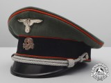 The Waffen-SS Visor Cap belonging to Obersturmbannfuhrer Erich Kühl (7./Art.-Rgt.)