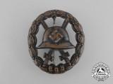 A German Condor Legion Black Grade Wound Badge; Hollow Type