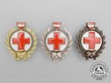 Three Austrian Red Cross Merit Breast Badges