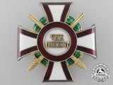 An Austrian Military Merit Cross with War Decoration and Swords by Rudol Souval