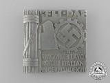 An Italian-German DAF/Workers Commemorative Badge