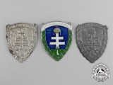 Three Hungarian Levente Cap Badges