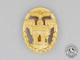 A Mint Third Reich Period German Defense Economy Leader Badge