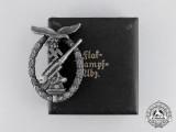 An Early War Luftwaffe Flak Badge by Juncker in its Case of Issue