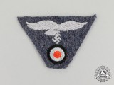 A Mint and Unissued Luftwaffe EM/NCo's M43 Trapezoid Cap Insignia