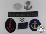 A Lot of Seven Kriegsmarine Insignia and Identification Tags