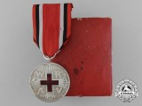 A Prussian Red Cross Medal; 2nd Class with Case