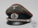A German Army Flak Officer's Visor Cap by Clemens Wagner