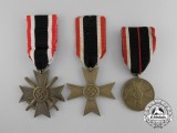 A Group of Three War Merit Medals and Crosses