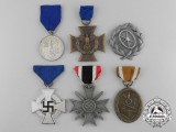 A Grouping of Six Fine Quality Manufacture Second War German Salesman's Medals, Awards, and Decorations