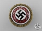 A NSDAP Golden Party Badge by Deschler & Sohn belonging to Willy Fritzsche
