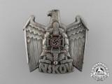 A Third Reich Period NSKOV Supporter's Badge by Deschler & Sohn