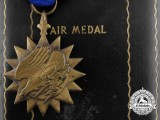 An American Air Medal; Named with Case