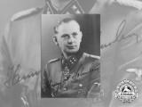 A Signed Photograph of Knight's Cross & German Cross Recipient SS-Sturmbannführer Lohmann