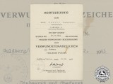 A Wound Badge in Black Document to Artillery Senior Gunner Ernst Heller