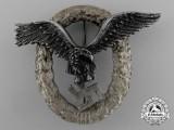An Early Quality Luftwaffe Pilot's Badge by C.E Juncker of Berlin