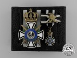 A Cased Prussian House Order of Hohenzollern; Knight's Cross with Swords by Sy & Wagner