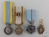 Four Miniature French Orders and Medals