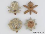 Four WWI & WWII British Cap Badges