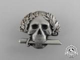A Second War Italian Black Brigade Skull Badge