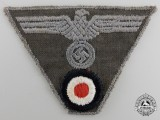 A Wehrmacht NCO M44 Cap Insignia