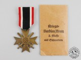 A War Merit Cross Second Class with Swords in its Packet of Issue by Türk's Witwe