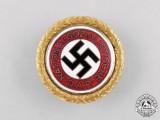 An NSDAP Golden Party Badge to SS Sturmbannarzt  Karl Jordan