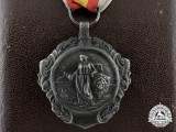 A Spanish Military Merit Medal with Case and Miniature